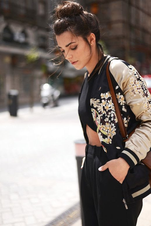 Le Fashion Blog Spring Blogger Style Top Knot Embroidered Floral Bomber Jacket Black Crop Top Brown Shoulder Bag Pants Via The Fashion Through My Eyes