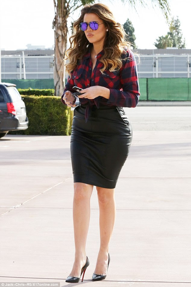 Purple patch: Khloe accessorised with brightly coloured aviator shades and a delicate cross necklace
