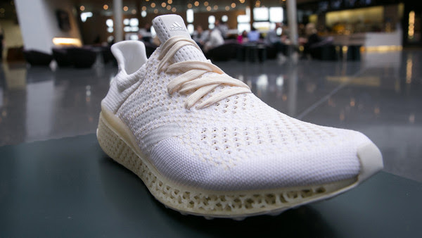 An Adidas prototype sneaker with a 3D printed sole sits on display ahead of a news conference to announce Adidas AG's earnings in Herzogenaurach, Germany, on Thursday, March 3, 2016. German sport-shoe maker Adidas forecast sales and earnings to increase as much as 12 percent this year as consumers spend more ahead of the Euro 2016 soccer tournament. Photographer: Krisztian Bocsi/Bloomberg