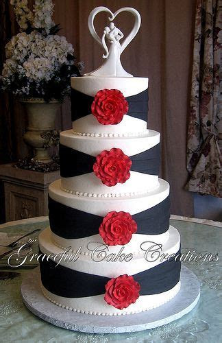 Elegant White and Black Wedding Cake with Red Roses in