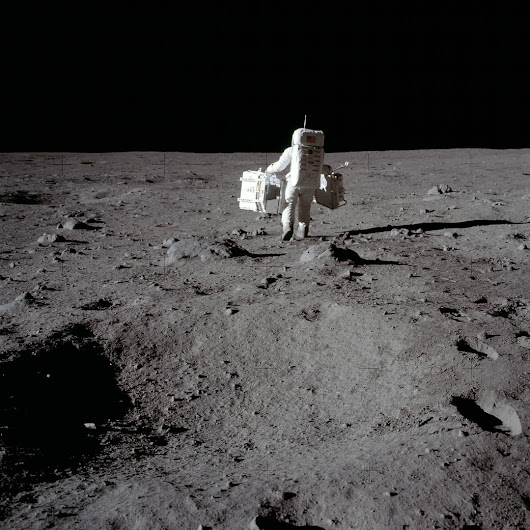 Buzz Aldrin carrying Scientific Equipment at Tranquility Base.