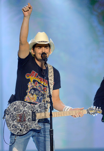 Brad Paisley Singer Brad Paisley  performs onstage at the 46th Annual Academy Of Country Music Awards held at the MGM Grand Garden Arena on April 3, 2011 in Las Vegas, Nevada.