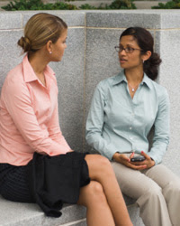 Photo: Two women having a conversation