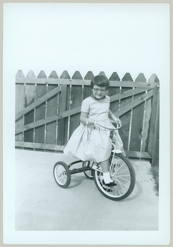 Child with tricycle