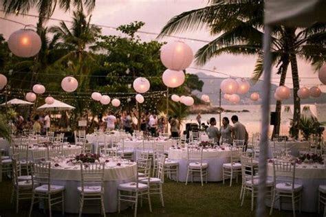 Thailand beach front outdoor wedding reception under fairy