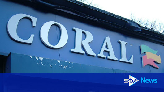 Armed robber threatens staff with knife in raid on bookies