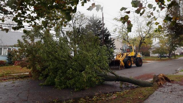 A tree felled by the storm blocks Kramer Drive in Lindenhurst, New York, on Monday.