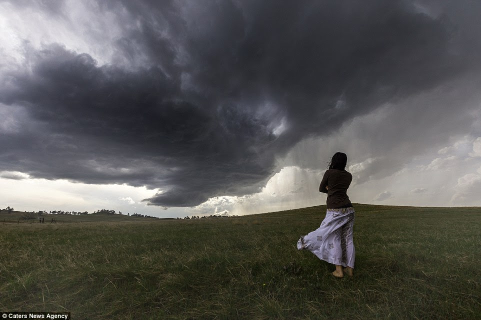 Dress for success: Daow's dress blows in the wind as the raging storms sweeps in