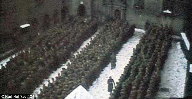Unearthed: The grainy colour film also shows prisoners gathered for a roll call in the isolated Renaissance castle