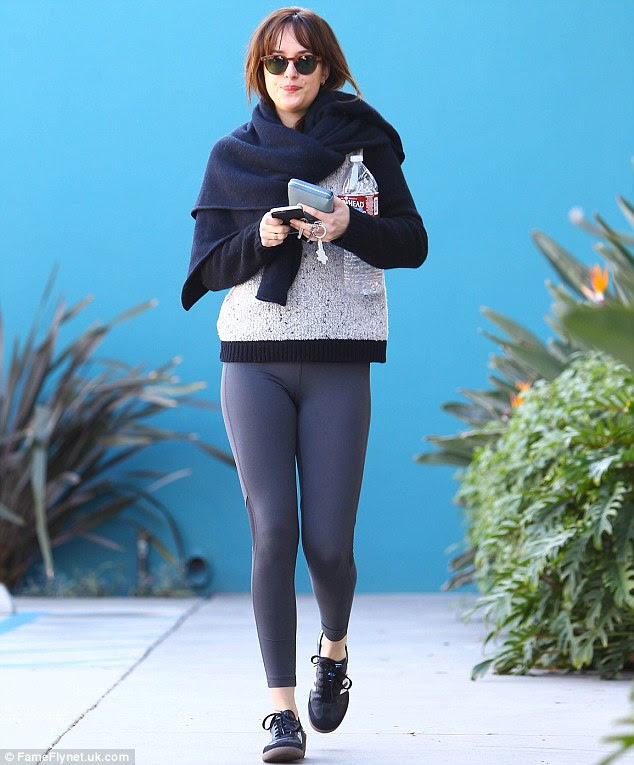 Fab and fit! Dakota Johnson showed off her trim shape as she left a Pilates class in West Hollywood on Friday