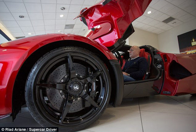 Worth the wait: Mr Bailey, pictured inside his Ferrari, ordered the £1.2million hypercar about two years ago