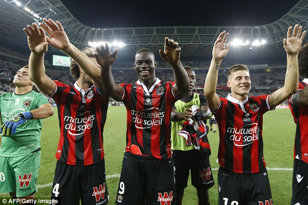 The Nice players, led by Balotelli, celebrate with the fans following their derby victory