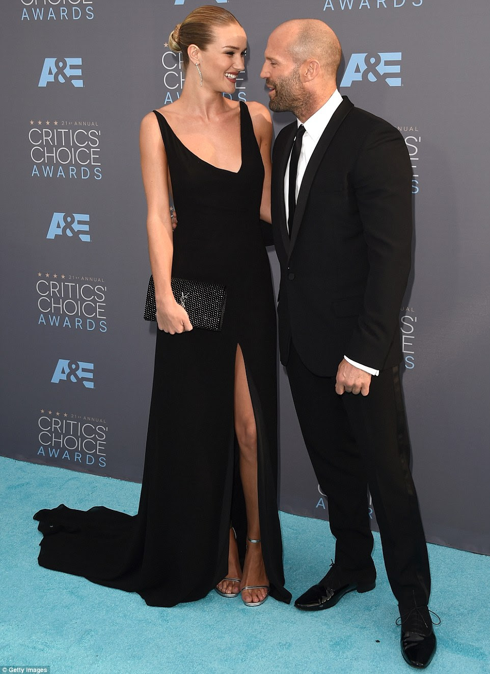 Still celebrating: The 28-year-old was there to support her new fiance Jason Statham, and the pair (both wearing Saint Laurent by Hedi Slimane) looked madly in love