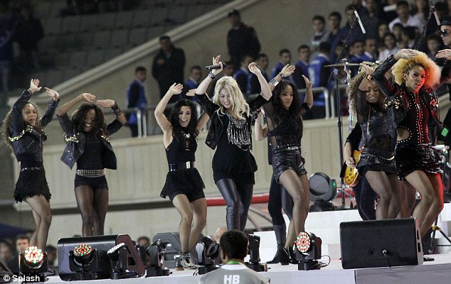 Still shaking it: Shakira showed off her growing baby bump onstage at the closing ceremony of FIFA U-17 Women's World Cup in Baku, Azerbaijan on Saturday