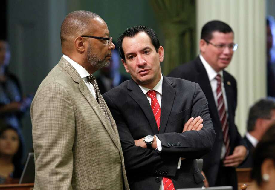 In this photo taken Wednesday Sept. 2, 2015,  Assemblyman Reginald Jones-Sawyer, Sr, D-Los Angeles, left, talks with Assembly Anthony Rendon, D-Lakewood, at the Capitol in Sacramento,Calif.  The Democratic caucus has voted, Thursday, for Rendon to become the 70th Assembly Speaker.  Rendon will take over from current Speaker,Toni Atkins, D-San Diego,  after a floor vote in January and a transition period to be determined by the Speaker and Speaker-elect. (AP Photo/Rich Pedroncelli) Photo: Rich Pedroncelli / Associated Press / AP