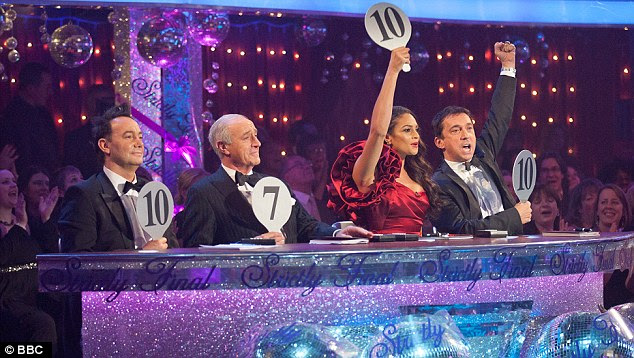 Festive sparkles: The judges give their scores for a performance on the show