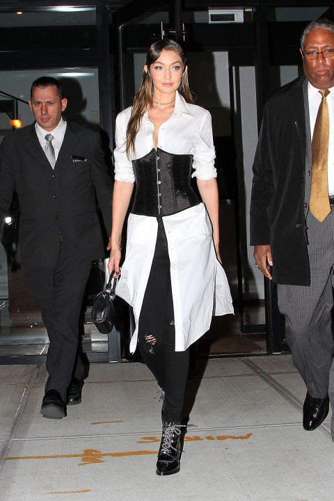 Offset the fitted structure of a full-on satin corset by layering it over a flowy white button-down as spotted on Gigi Hadid.