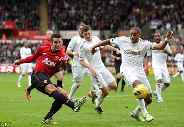 Off target: Williams again gets in the way, this time to stop Van Persie
