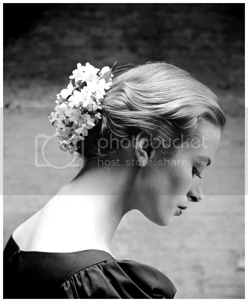 photo 1928-capucine-wearing-flowered-hair-ornament-as-chignon-photo-by-yale-joel-1950s.jpg
