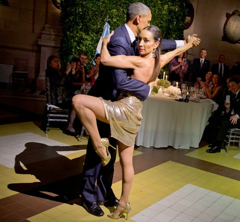 President Barack Obama does the tango with a dancer during the state dinner at the Centro Cultural Kirchner, Wednesday, March 23, 2016, in Buenos Aires.