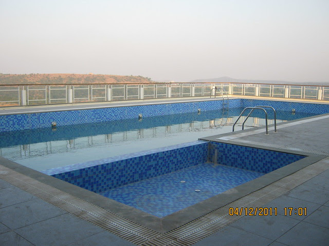 Swimming Pool at the club house - Visit to Paranjape Schemes' Forest Trails, Bungalows, 2 BHK & 3 BHK Flats at Bhugaon, Pune 411 042