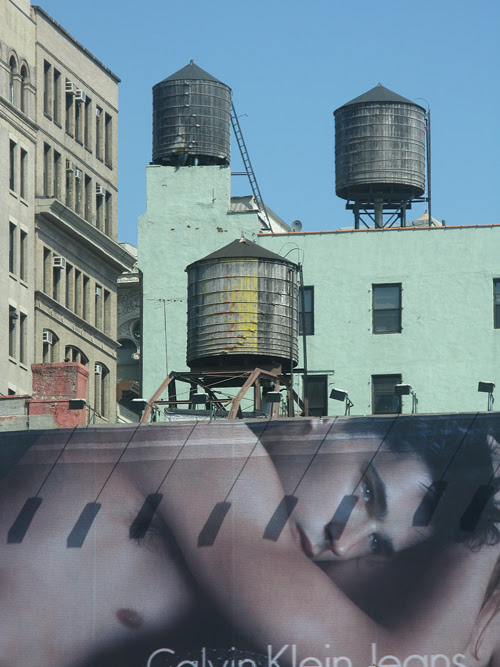 Calvin Klein billboard and three water towers, Manhattan, NYC