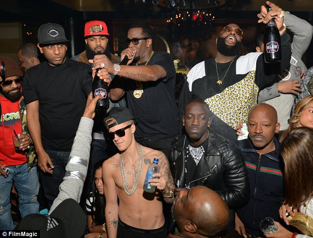 Hardman: Justin ditched his hoodie to party with a group of rappers including Diddy on Wednesday night
