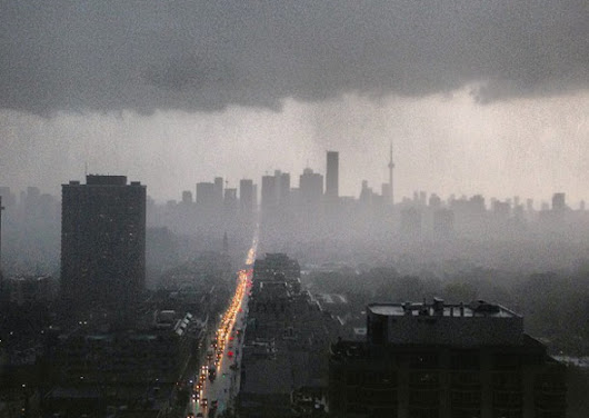 Massive rain storm hits Toronto causing flooding and power outages