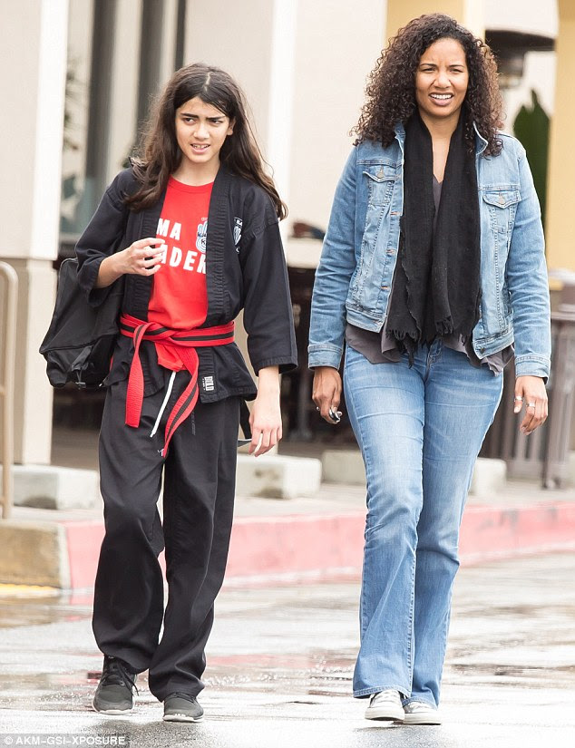 Blanket Jackson continue his discipline in a black karate ji and ...
