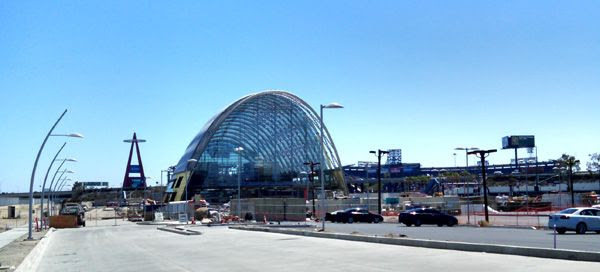 A new Metro bus station undergoing construction in Orange County...with Angel Stadium of Anaheim visible in the background.