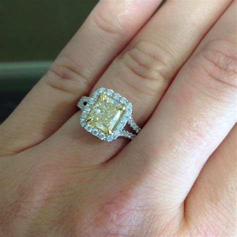 This 2 carat canary yellow, cushion cut, diamond ring is a