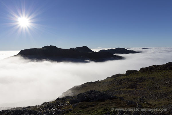01M-3113 Esk Pike and Bow Fell Isolated by Mist Created by a Temperature Inversion Viewed From Great End Lake District Cumbria UK.