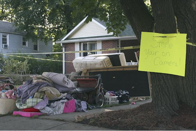 Contents from a home flooded by Hurricane Irene sit in the front yard with a warning sign, Wednesday, Aug. 31, 2011 in Washingtonville, N.Y. Irene destroyed 500 to 600 homes and thousands of acres of