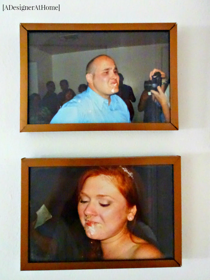 husband and wife candid cash smash photos from the wedding day hung in their hallway