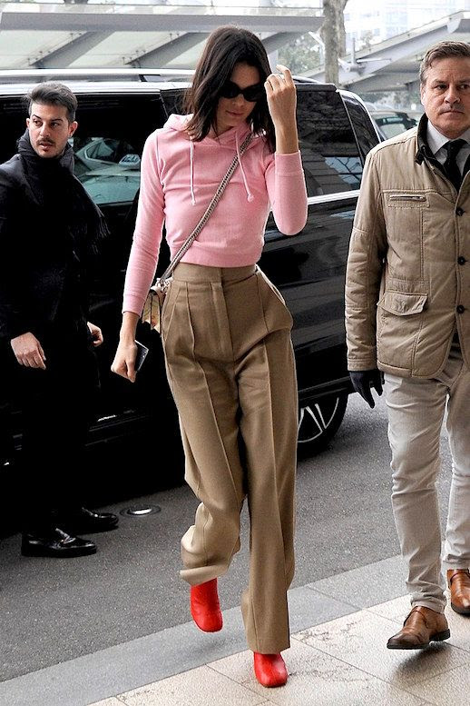 Le Fashion Blog Kendall Jenner Milan Fashion Week Pink Hoodie Cropped Camel Trousers Red Boots Via Vogue