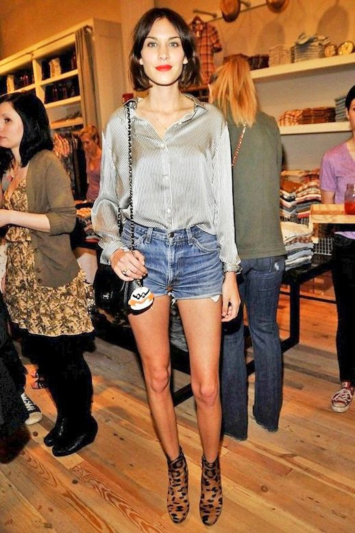 9 Le Fashion Blog 40 Of Alexa Chung Best Looks With Denim Shorts Silk Striped Shirt Jean Cut Offs Leopard Boots Via Look