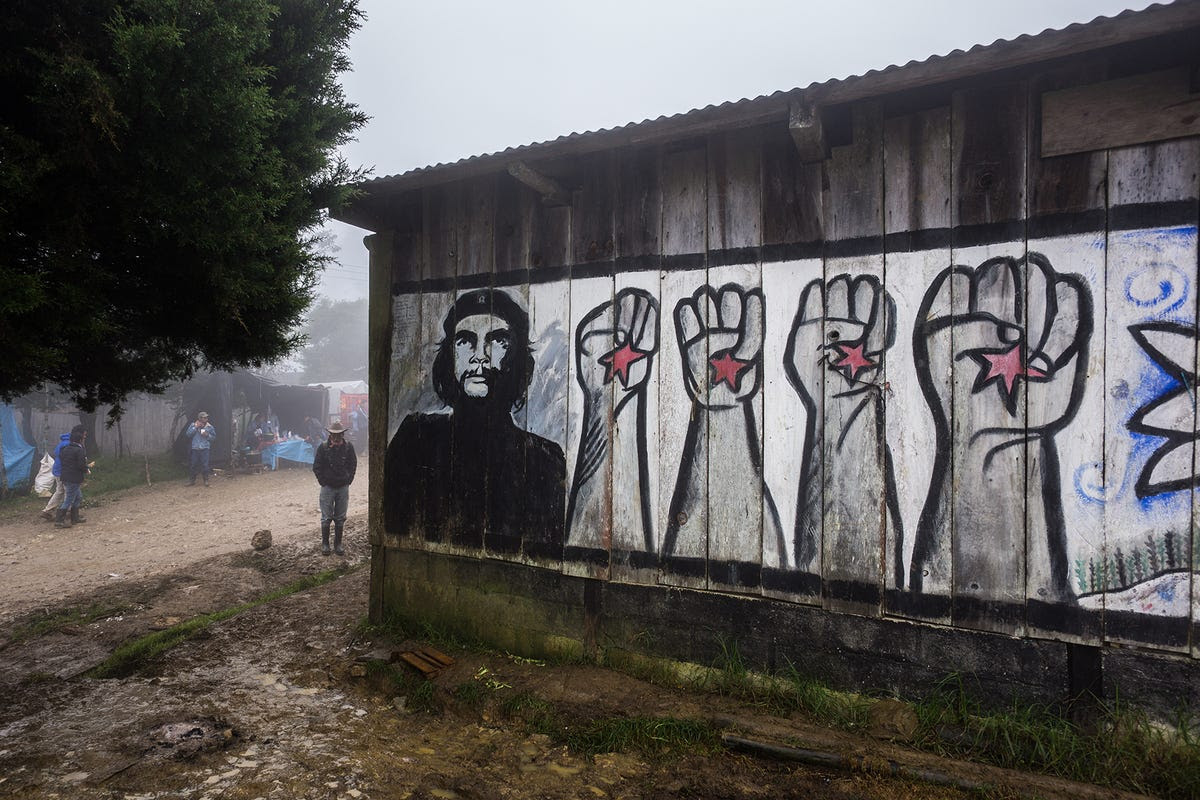 """Zapatista art and murals has long depicted cultural heroes of resistance, like Emiliano Zapata or Che Guevara, seen here. A sign on the outskirts of one of the towns reads, """"'Here, the people give the orders and the government obeys."""""""