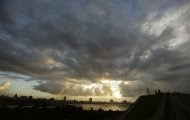 Storm clouds fill the sky over Havana October 24, 2012. Hurricane Sandy battered Jamaica with ferocious winds, waves and rain on Wednesday, knocking down trees and power lines across the Caribbean country as it cut a path toward Cuba and the Bahamas. REUTERS/Desmond Boylan