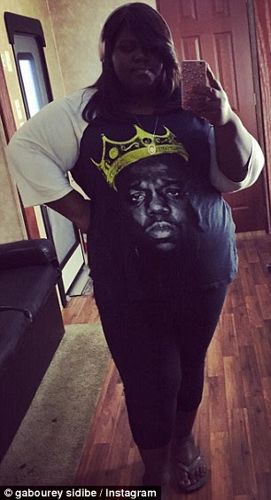 Dramatic change: (L) Gabourey is seen sporting a Biggie Smalls T-shirt two weeks ago. (R) The actress is pictured in the 2009 drama, Precious