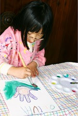 Olivia Painting with Watercolors on Canvas