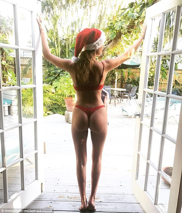 'Naughty or nice?' Millie Mackintosh, 28, oozed sex appeal as she took to Instragram with a cheeky snap of her derriere while on holiday in Florida with her fiancé Hugo Taylor