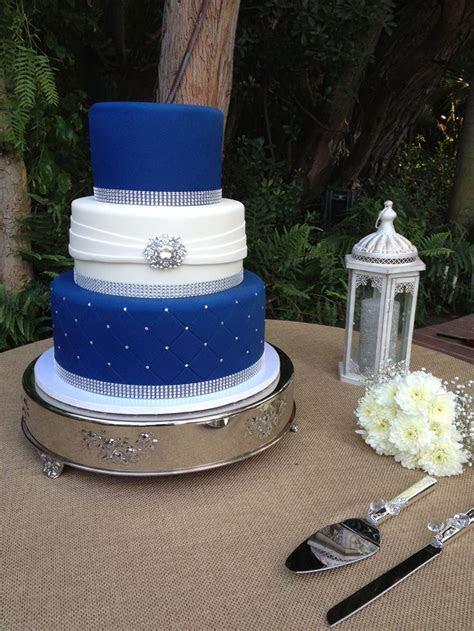 Three tier fondant wedding cake. Royal blue and white