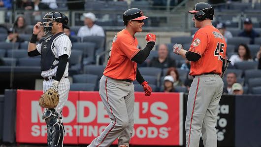 Yankees rally; Orioles' clinch plans on hold