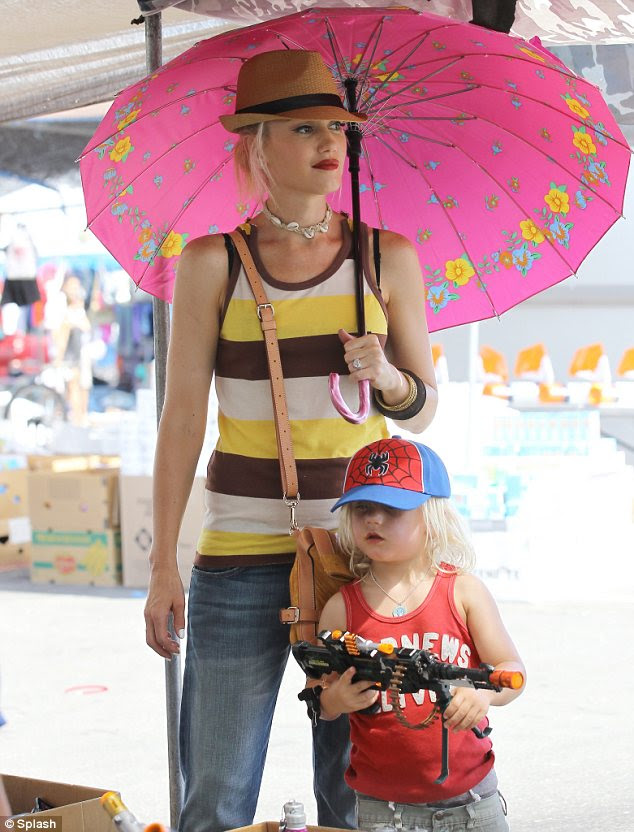 Shielded from the sun: Gwen STefani was armed with a colourful parasol when she took sons Kingston and Zuma (pictured) out today