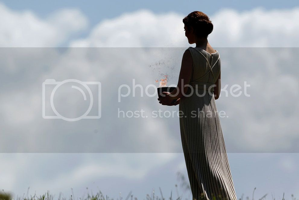 A priestess holding a lit cauldron performs in the final dress rehearsal for the lighting of the flame held on May 9, 2012, in ancient Olympia, Greece. (AP Photo/Petros Giannakouris)