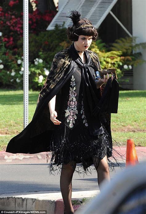 Lady Gaga wears 1920s inspired dress and headband on