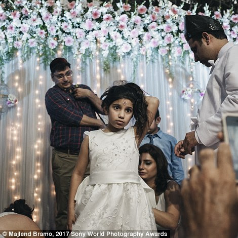 In Mumbai, India, a little girl undergoes a Navjote, pictured, a ceremony similar to baptism which welcomes her into the Zoroastrian religion - one of the oldest on Earth. It means she'll never be allowed to marry outside of it.