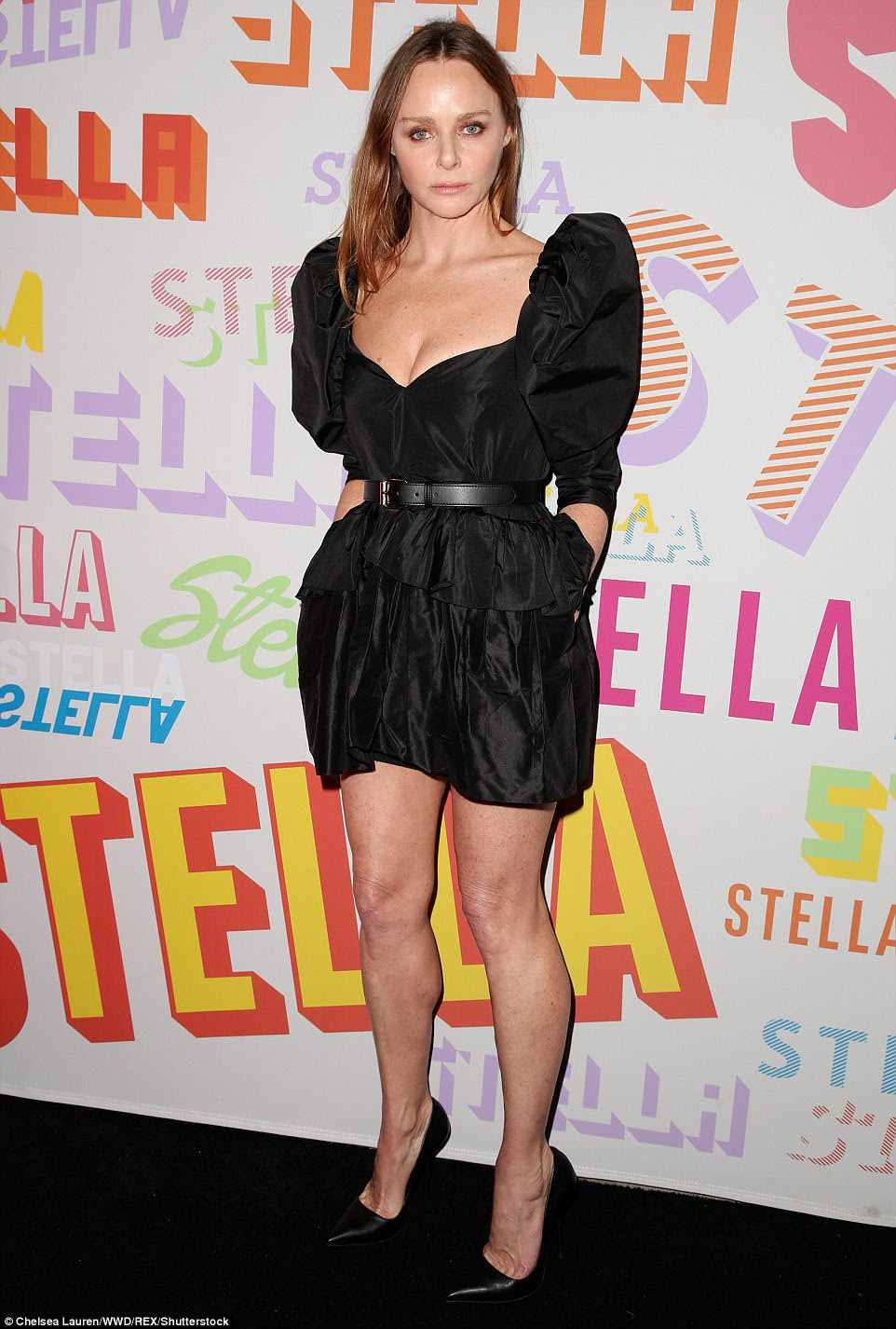 Woman of the hour: At her own event, Stella rocked a high-shouldered black mini-dress that played up her cleavage, cinching a belt round her enviably trim waistline