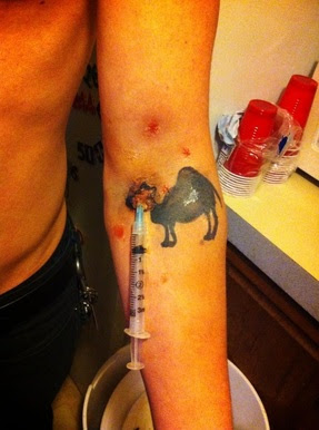 Guy Showing His Camel Tattoo