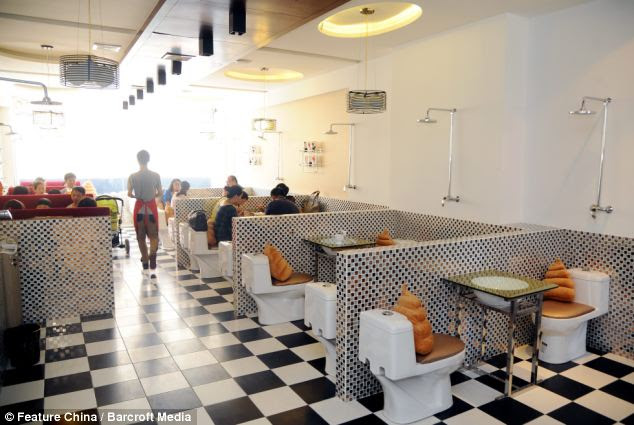 Groom of the stool: Waiters serve patients at seats that are adorned with poo-shaped cushions
